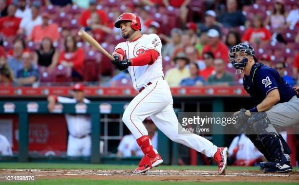 Eugenio Suarez of the Cincinnati Reds hits a double in the first inning against the Milwaukee Brewers at Great American Ball Park on August 28 2018...