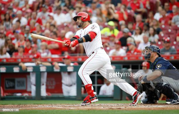 Eugenio Suarez of the Cincinnati Reds hits a double in the first inning against the Milwaukee Brewers at Great American Ball Park on June 28 2018 in...