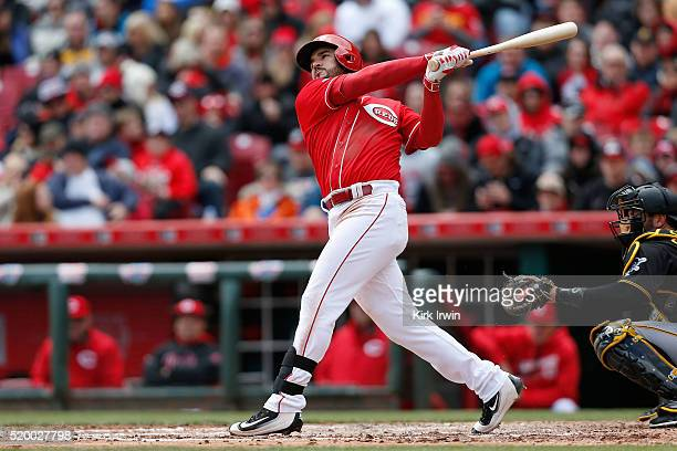 Eugenio Suarez of the Cincinnati Reds hits a foul ball during the third inning of the game against the Pittsburgh Pirates at Great American Ball Park...