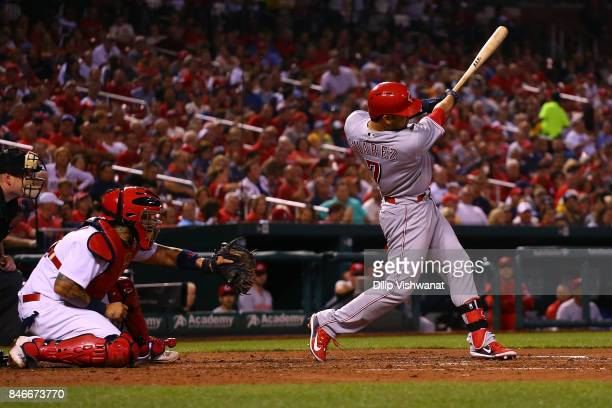 Eugenio Suarez of the Cincinnati Reds hits a grand slam against the St Louis Cardinals in the fifth inning at Busch Stadium on September 13 2017 in...