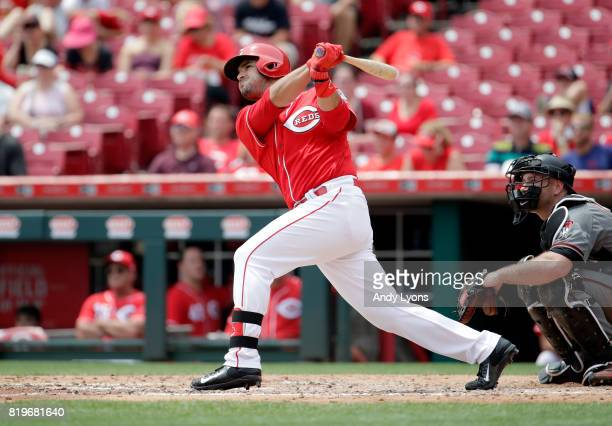 Eugenio Suarez of the Cincinnati Reds hits a home run in the fourth inning against the Arizona Diamondbacks at Great American Ball Park on July 20...