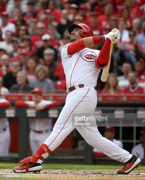 Eugenio Suarez of the Cincinnati Reds hits a pop fly during the first inning of the game against the Pittsburgh Pirates on Opening Day at Great...