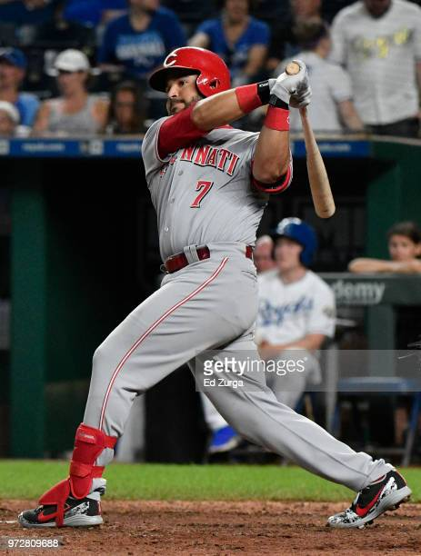 Eugenio Suarez of the Cincinnati Reds hits a RBI single in the 10th inning against the Kansas City Royals at Kauffman Stadium on June 12 2018 in...
