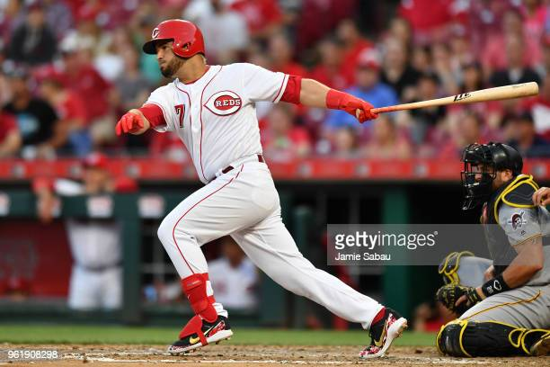Eugenio Suarez of the Cincinnati Reds hits a single in the fourth inning against the Pittsburgh Pirates at Great American Ball Park on May 23 2018 in...