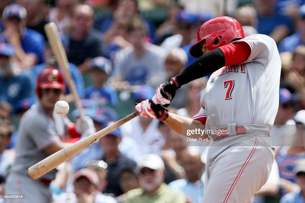 Eugenio Suarez #7 of the Cincinnati Reds hits a single in the second inning against the Chicago Cubs at Wrigley Field on August 17, 2017 in Chicago, Illinois.