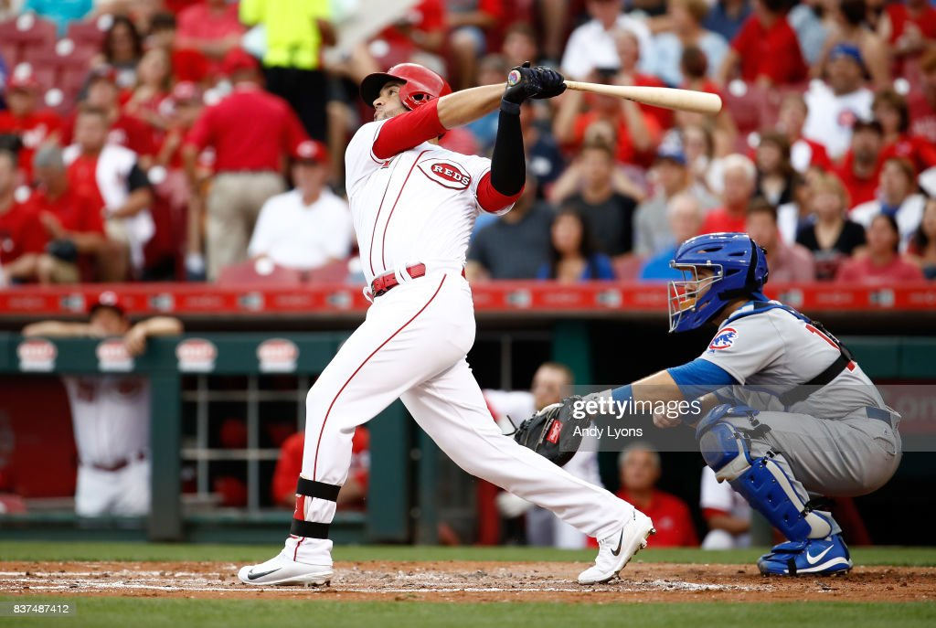Eugenio Suarez #7 of the Cincinnati Reds hits a single in the second inning against the Chicago Cubs at Great American Ball Park on August 22, 2017 in Cincinnati, Ohio.