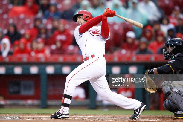 Eugenio Suarez of the Cincinnati Reds hits a threerun home run in the first inning of a game against the Pittsburgh Pirates at Great American Ball...