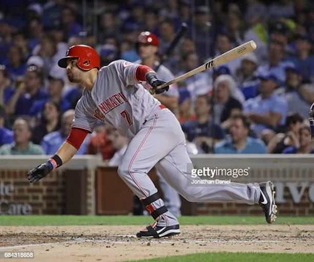 Eugenio Suarez of the Cincinnati Reds hits a two run double in the 7th inning against the Chicago Cubs at Wrigley Field on May 17 2017 in Chicago...