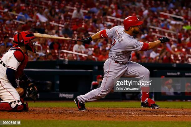 Eugenio Suarez of the Cincinnati Reds hits a twoRBI single against the St Louis Cardinals in the seventh inning at Busch Stadium on July 14 2018 in...