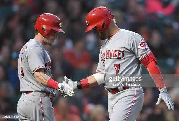 Eugenio Suarez of the Cincinnati Reds is congratulated by Scooter Gennett after Suarez hit a tworun home run against the San Francisco Giants in the...