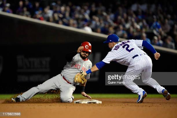 Eugenio Suarez of the Cincinnati Reds is tagged out at second base in the sixth inning by Nico Hoerner of the Chicago Cubs at Wrigley Field on...