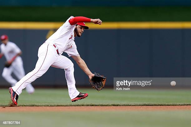 Eugenio Suarez of the Cincinnati Reds is unable to field a ground ball hit by Stephen Piscotty of the St Louis Cardinals during the first inning of...