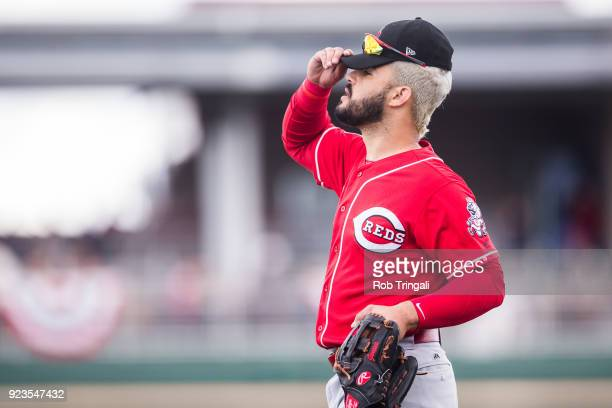 Eugenio Suarez of the Cincinnati Reds looks on against the Cleveland Indians during a Spring Training Game at Goodyear Ballpark on February 23 2018...