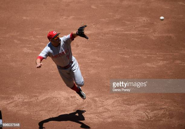 Eugenio Suarez of the Cincinnati Reds makes a leaping catch on a ball off the bat of Yangervis Solarte of the San Diego Padres during the third...