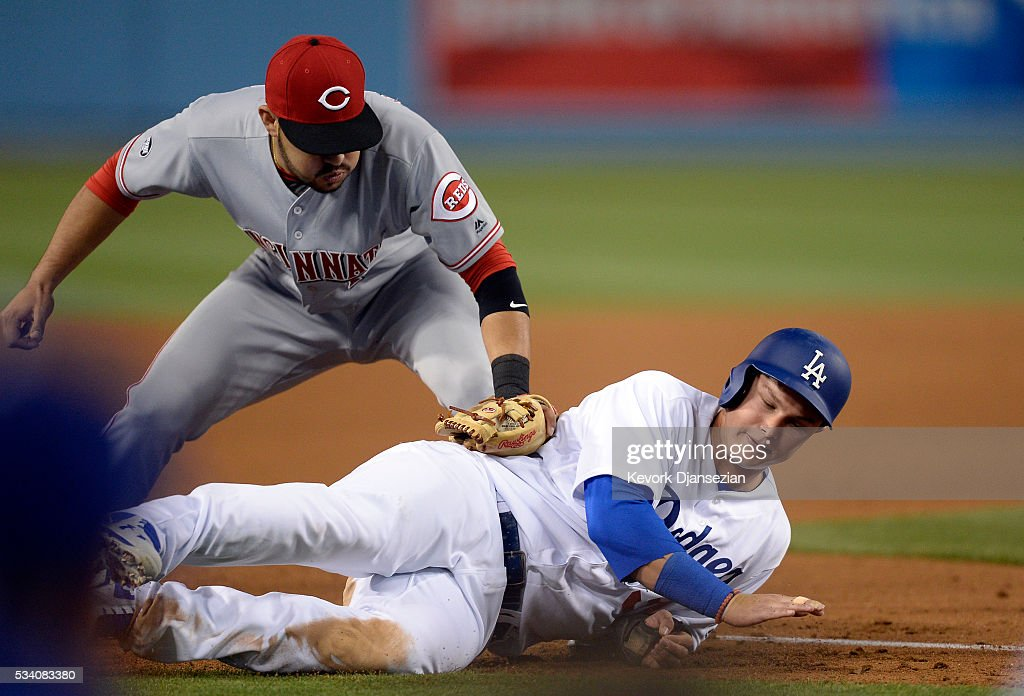 Eugenio Suarez #7 of the Cincinnati Reds puts the tag on Joc Pederson #31 of the Los Angeles Dodgers after he was caught in a rundown between home and third base during the sixth inning of the baseball game at Dodger Stadium May 24, 2016, in Los Angeles, California.