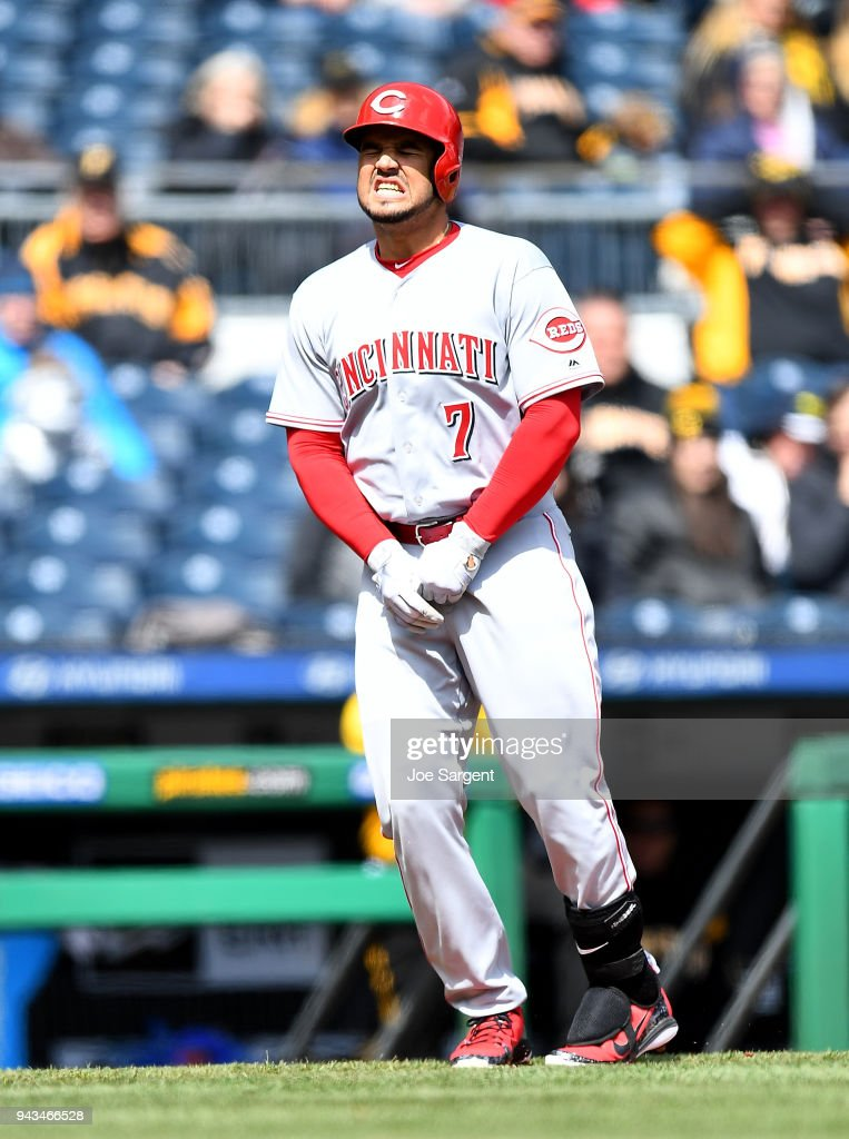 Eugenio Suarez #7 of the Cincinnati Reds reacts after being hit by a pitch during the fourth inning against the Pittsburgh Pirates at PNC Park on April 8, 2018 in Pittsburgh, Pennsylvania.