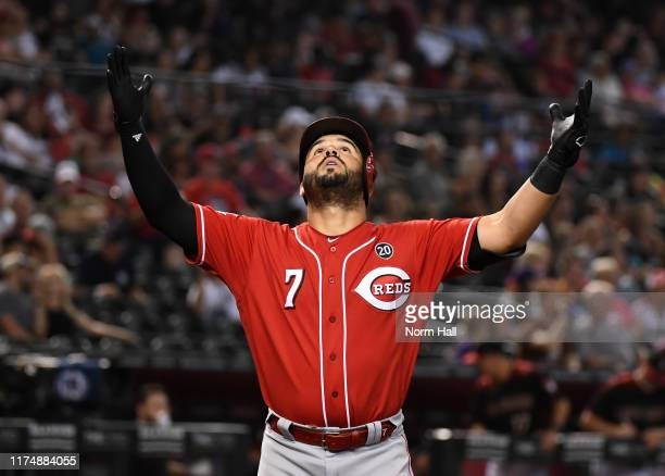 Eugenio Suarez of the Cincinnati Reds reacts after hitting a solo home run off of Zac Gallen of the Arizona Diamondbacks during the fourth inning at...