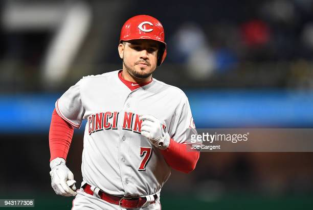 Eugenio Suarez of the Cincinnati Reds reacts after hitting a three run home run during the eighth inning against the Pittsburgh Pirates at PNC Park...