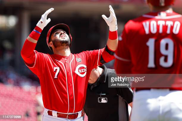 Eugenio Suarez of the Cincinnati Reds reacts after hitting a tworun home run in the first inning against the San Francisco Giants at Great American...