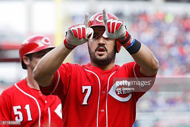 Eugenio Suarez of the Cincinnati Reds reacts after hitting a tworun home run in the second inning against the Chicago Cubs at Great American Ball...