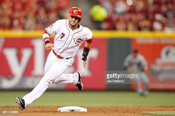 Eugenio Suarez of the Cincinnati Reds rounds second base after a single by Tucker Barnhart against the Cleveland Indians in the second inning at...