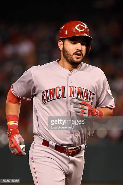 Eugenio Suarez of the Cincinnati Reds runs the bases after hitting a two run homerun in the seventh inning against the Los Angeles Angels of Anaheim...