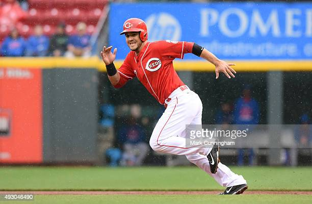Eugenio Suarez of the Cincinnati Reds runs the bases in the rain during the game against the Chicago Cubs at Great American Ball Park on October 1...