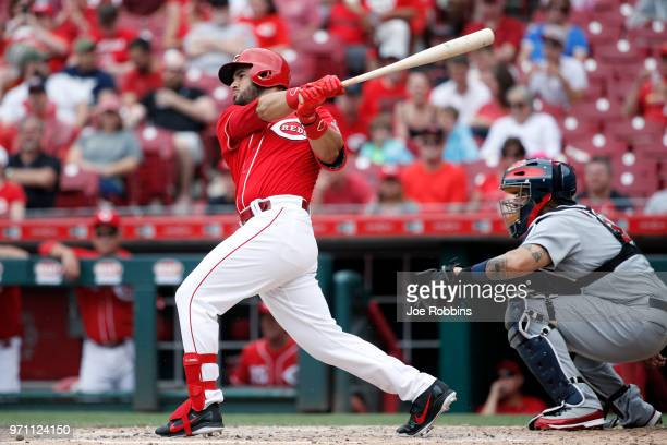 Eugenio Suarez of the Cincinnati Reds singles to center field to drive in a run in the fourth inning against the St Louis Cardinals at Great American...