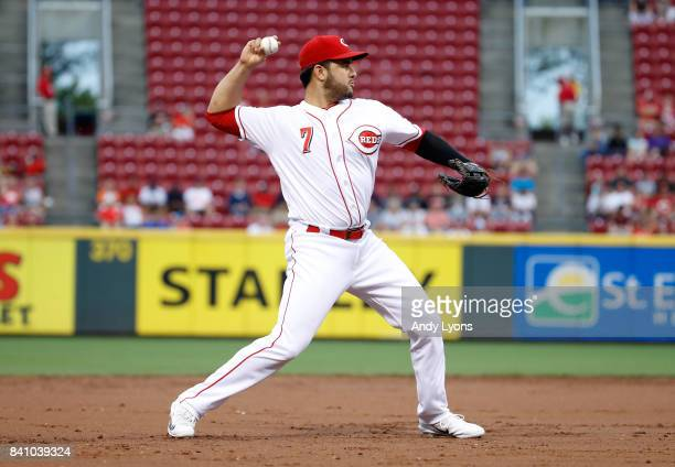 Eugenio Suarez of the Cincinnati Reds throws the ball to first base against the New York Mets at Great American Ball Park on August 30 2017 in...