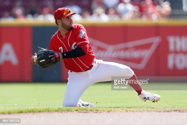 Eugenio Suarez of the Cincinnati Reds throws the ball to first base during the game against the Boston Red Sox at Great American Ball Park on...
