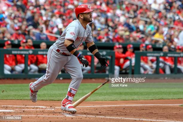 Eugenio Suarez of the Cincinnati Reds watches the ball as he runs for a RBI double during the third inning against the St Louis Cardinals at Busch...