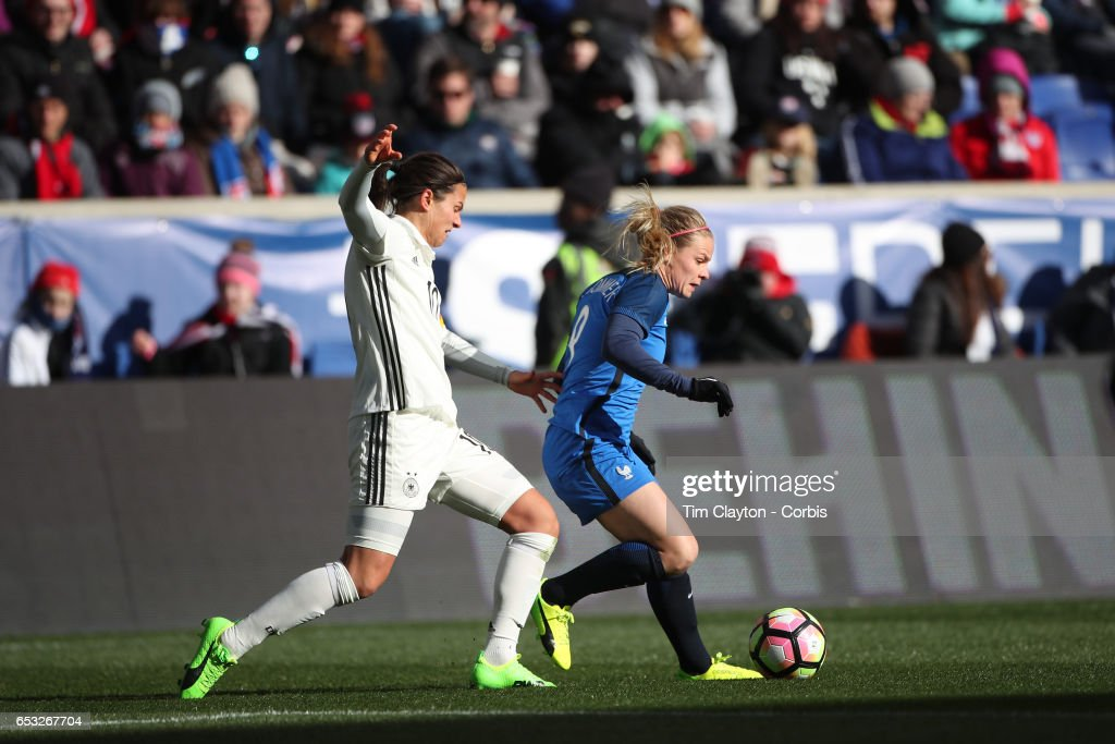 Eugénie Le Sommer #9 of France is challenged by Dzsenifer Marozsán #10 of Germany during the France Vs Germany SheBelieves Cup International match at Red Bull Arena on March 4, 2017 in Harrison, New Jersey.
