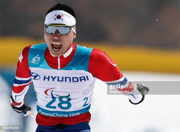Eui Hyun Sin of Korea crosses the finish line in third place in the Men's 15km Sitting CrossCountry event at Alpensia Biathlon Centre during day two...