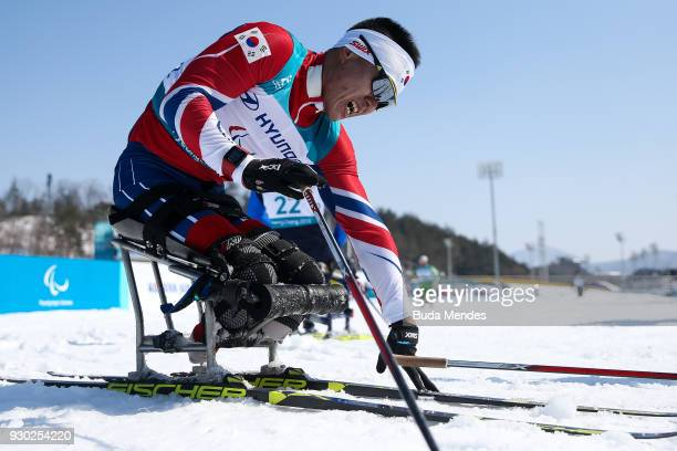 Eui Hyun Sin of Korea reacts after cross the finish line in third place in the Men's 15km Sitting CrossCountry event at Alpensia Biathlon Centre...