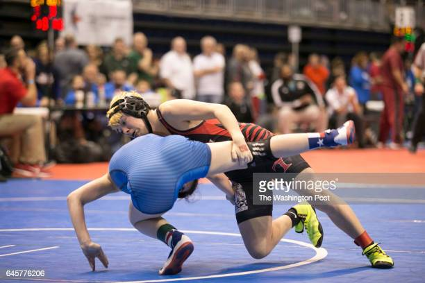 Euless Trinty Highschool junior Mack Beggs in black, a transgender wrestler competing in the girls state championship tournament, wrestles against...