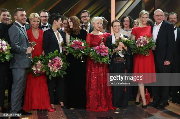 Eulogists of the evening and awardees Edin Hasanovic Dunja Hayali Julianne Moore Helen Mirren and Maria Simon pose on stage after the 51st...