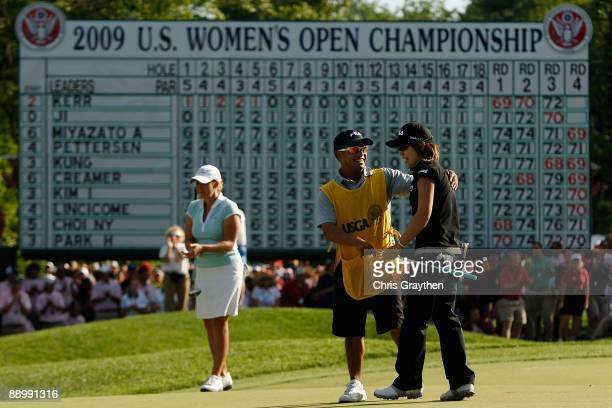 Eun Hee Ji of South Korea celebrates with her caddy Zac Austin after putting in for birdie on the 18th hole to win the final round of the 2009 US...