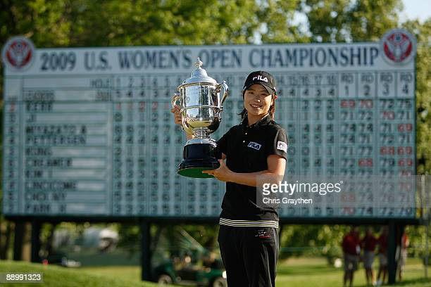 Eun Hee Ji of South Korea celebrates with the winner's trophy after winning the final round of the 2009 U.S. Women's Open at Saucon Valley Country...