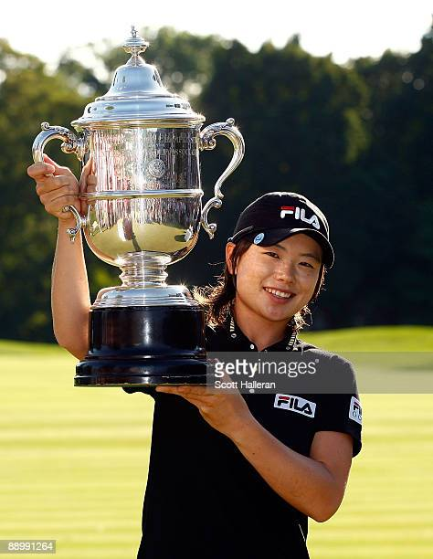 Eun Hee Ji of South Korea poses with the trophy after her one-stroke victory at the 2009 U.S. Women's Open at the Saucon Valley Country Club on July...