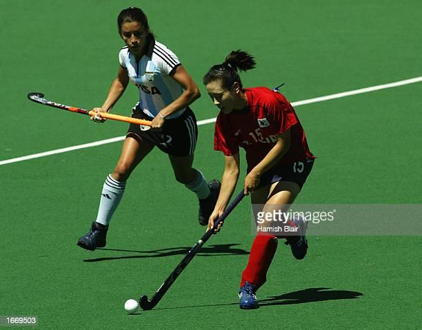 Eun Young Lee of Korea runs off Mariana Gonzalez Olivia of Argentina during the Women's World Cup Hockey match between Argentina and Korea at the...