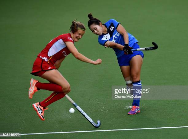 Eunbi Cheon of Korea and SophieAnne Weyns of Belgium during the Fintro Hockey World League SemiFinal quarter final playoff game between Korea and...