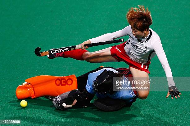 Eunbi Cheon of Korea falls over goalkeeper Sally Rutherford of New Zealand in the penalty shoot out during the Fintro Hockey World League SemiFinal...