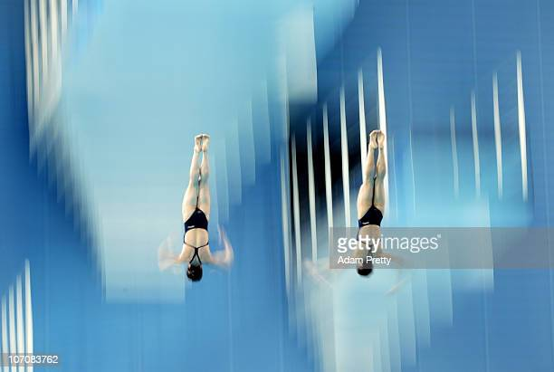 Eunbi Cho and Seung Eun Yun of DPR Korea compete in the Women's Synchronised 10m Platform at Aoti Aquatics Centre during day ten of the 16th Asian...