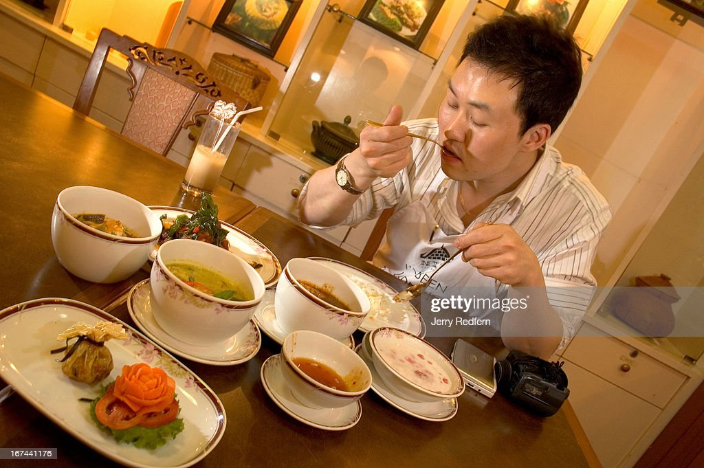 Eung-Yup Lee, a chef with the Ibis hotel in Seoul, Korea, tastes the various dishes cooked at a class at the Landmark Hotel Cooking School..