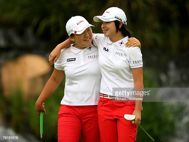 EunHee Ji and JiYai Shin of Korea console each other on the 18th green after finishing second during the final round of the Women's World Cup of Golf...