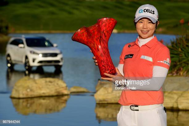 EunHee Ji of Korea celebrates her 16 under par victory with the winners trophy during the Final Round of the LPGA KIA CLASSIC at the Park Hyatt...