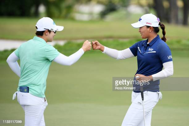 EunHee Ji of South Korea and Jin Young Ko of South Korea bump fists on the 18th green during the third round of the HSBC Women's World Championship...