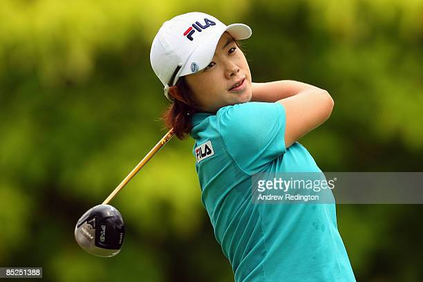 EunHee Ji of South Korea watches her tee shot on the sixth hole during the first round of the HSBC Women's Champions at Tanah Merah Country Club on...
