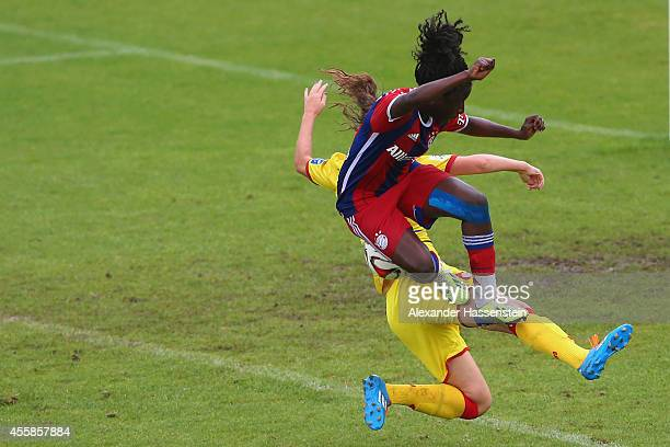 Eunice Beckmann of Muenchen battles for the ball with Tamar Dongus of Hoffenheim during the Allianz FrauenBundesliga match between FC Bayern Muenchen...