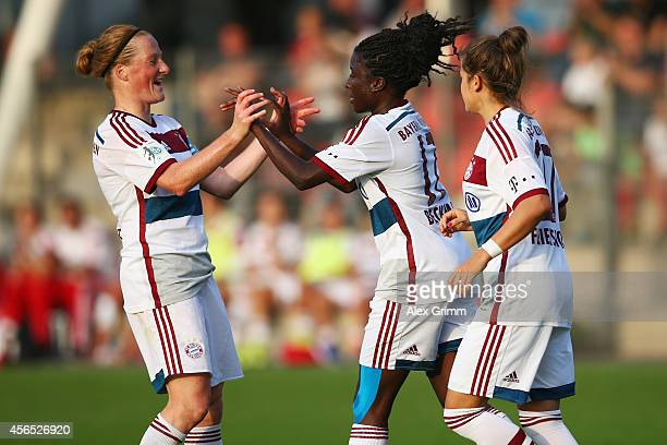 Eunice Beckmann of Muenchen celebrates her team's fourth goal with team mates Melanie Behringer and Laura Feiersinger during the Allianz...